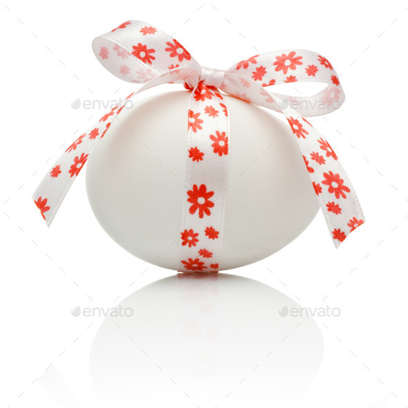 Easter egg with festive bow isolated on white background - Stock Photo - Images