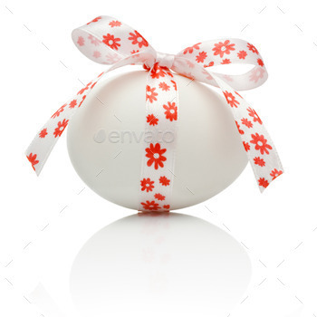 Easter egg with festive bow isolated on white background