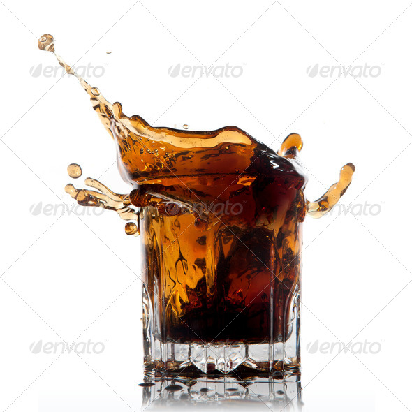 splash of cola in glass isolated on white - Stock Photo - Images