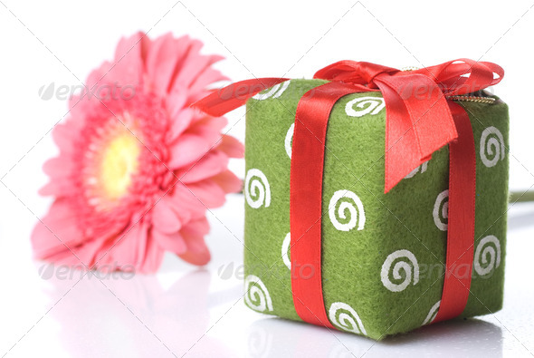 Gift with pink daisy-gerbera on white - Stock Photo - Images