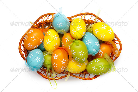 color easter eggs in basket isolated on white. top view - Stock Photo - Images