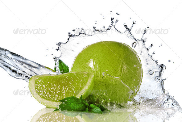 Water splash on lime with mint isolated on white - Stock Photo - Images