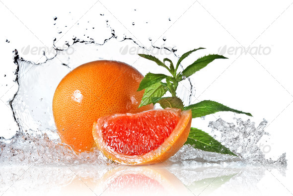 Water splash on grapefruit with mint isolated on white - Stock Photo - Images