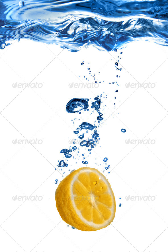 Fresh lemon dropped into water with bubbles isolated on white - Stock Photo - Images