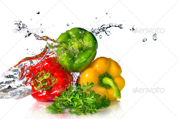 red, yellow, green pepper and parsley with water splash isolated - Stock Photo - Images