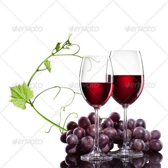 Red wine in glasses with grape and rod isolated on white - Stock Photo - Images