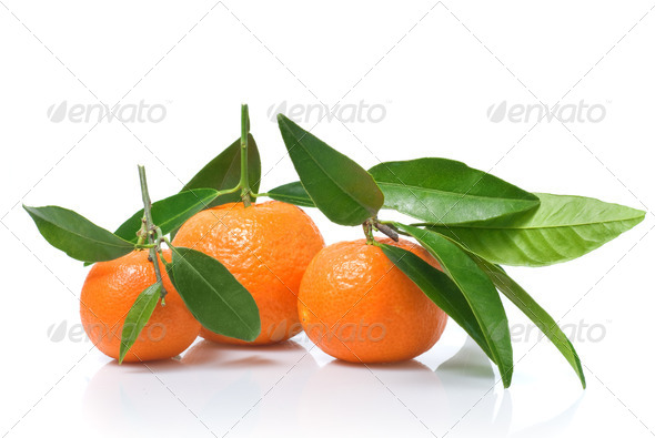 Tangerines with green leaves isolated on white - Stock Photo - Images