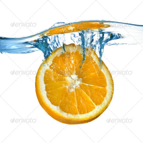 Fresh orange dropped into water with splash isolated on white - Stock Photo - Images