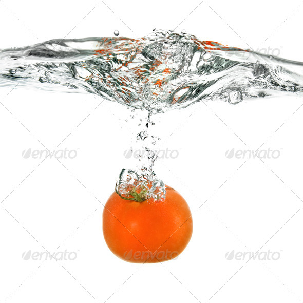 red tomato dropped into water isolated on white - Stock Photo - Images