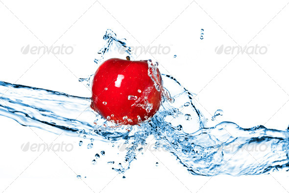Red apple and water splash isolated on white - Stock Photo - Images