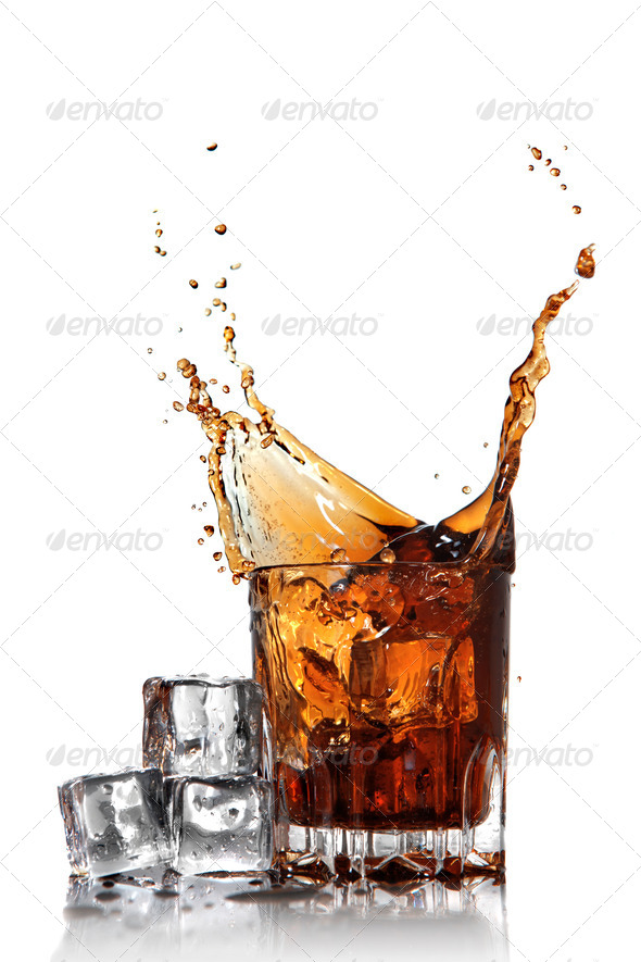 splash of cola in glass with ice cubes isolated on white - Stock Photo - Images