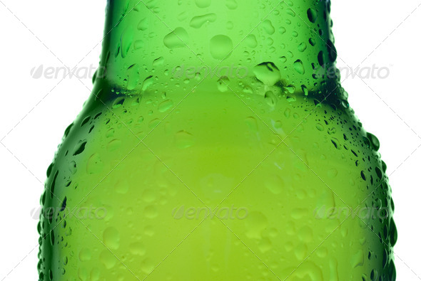 Green beer bottle with water drops isolated on white - Stock Photo - Images