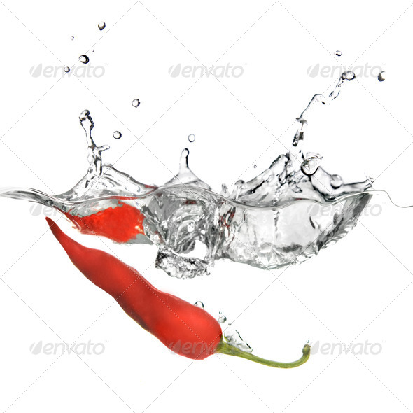 red pepper dropped into water with splash isolated on white - Stock Photo - Images