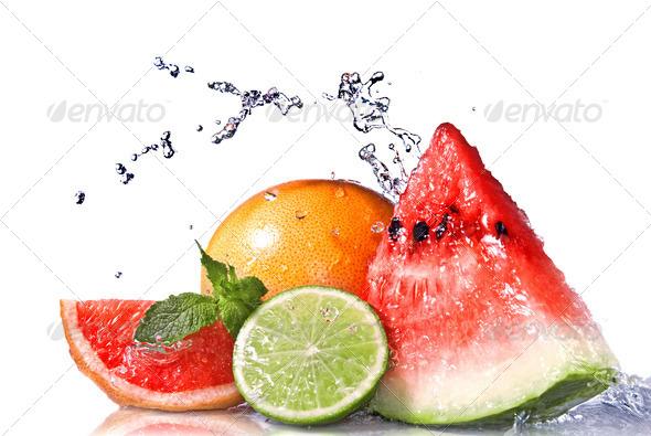 Water splash on fresh fruits isolated on white - Stock Photo - Images