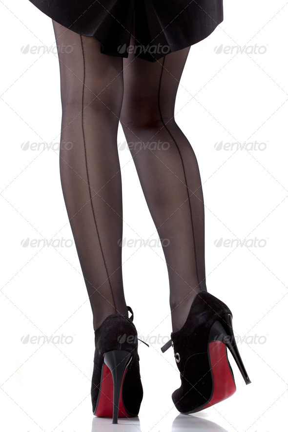 sexy woman legs and shoes isolated on white - Stock Photo - Images