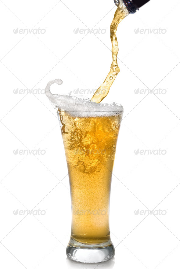 Beer pouring from bottle into glass isolated on white - Stock Photo - Images