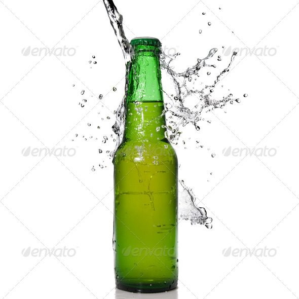 Green beer bottle with water splash isolated on white - Stock Photo - Images
