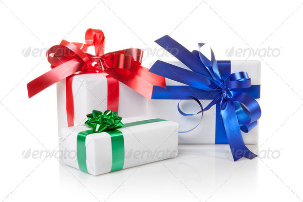 Holiday gifts with color ribbons isolated on white - Stock Photo - Images