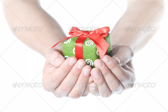 Hands holding gift isolated on white - Stock Photo - Images