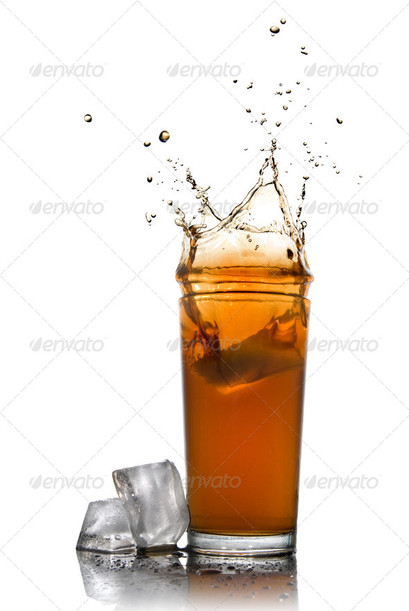 Beautiful splash of cola in glass and ice cubes isolated on whit - Stock Photo - Images