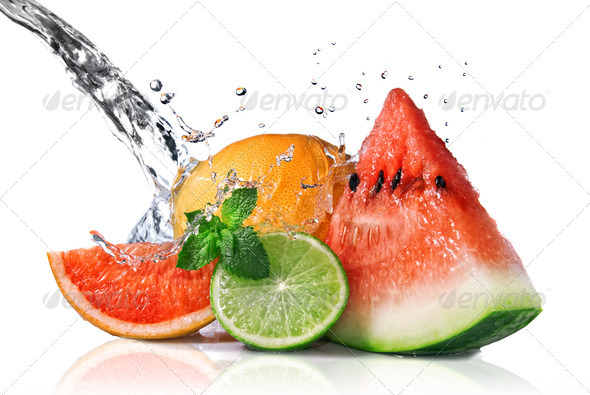 Water splash on fresh fruits isolated on white - Stock Photo - Images