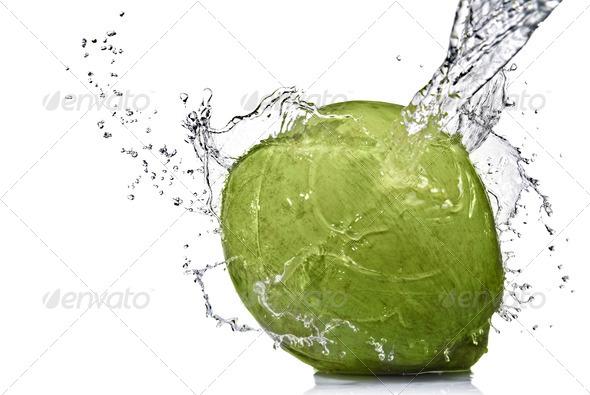 fresh water splash on coconut isolated on white - Stock Photo - Images