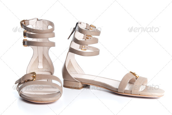 beigeleather female sandals isolated on white - Stock Photo - Images