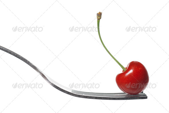 red cherry on fork isolated on white - Stock Photo - Images