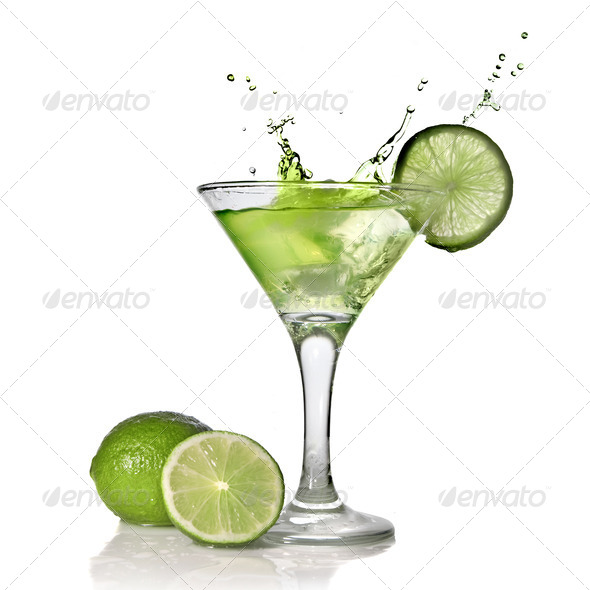 Green alchohol cocktail with splash and green lime isolated on w - Stock Photo - Images