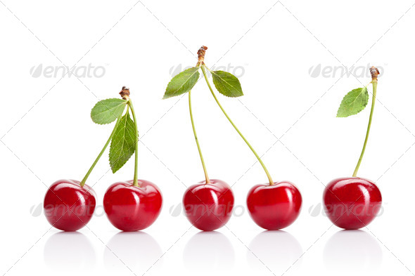 Red cherry with leaves isolated on white - Stock Photo - Images