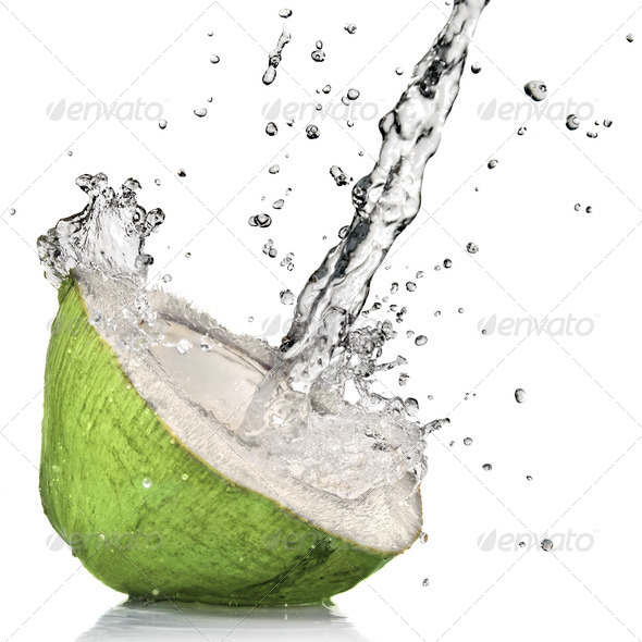 Green coconut with water splash isolated on white - Stock Photo - Images