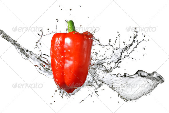 fresh water splash on red pepper isolated on white - Stock Photo - Images