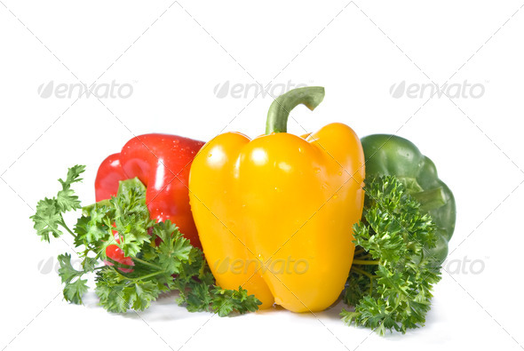 red, yellow and green pepper with parsley isolated on white - Stock Photo - Images