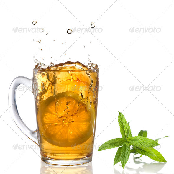 lemon dropped into tea cup with splash and mint isolated on whit - Stock Photo - Images