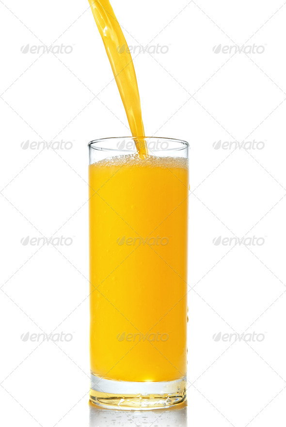 orange juice poring into glass isolated on white - Stock Photo - Images