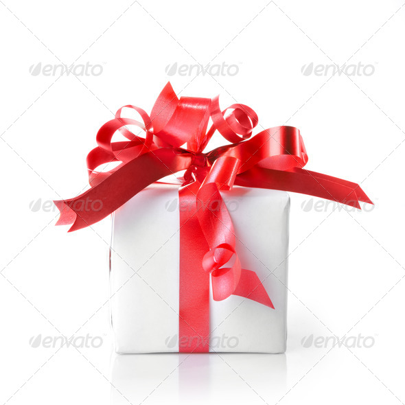 Holiday gift with red ribbon isolated on white - Stock Photo - Images