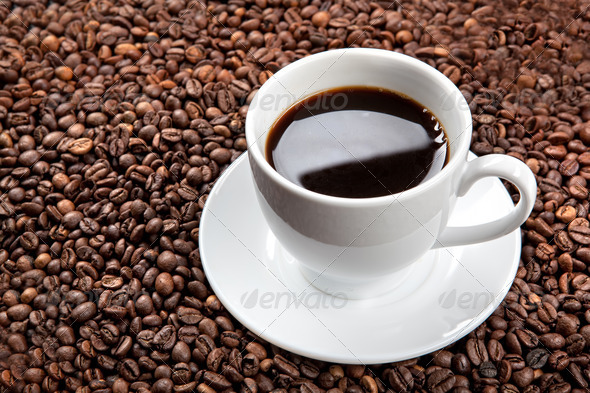 white cup with coffee beans - Stock Photo - Images