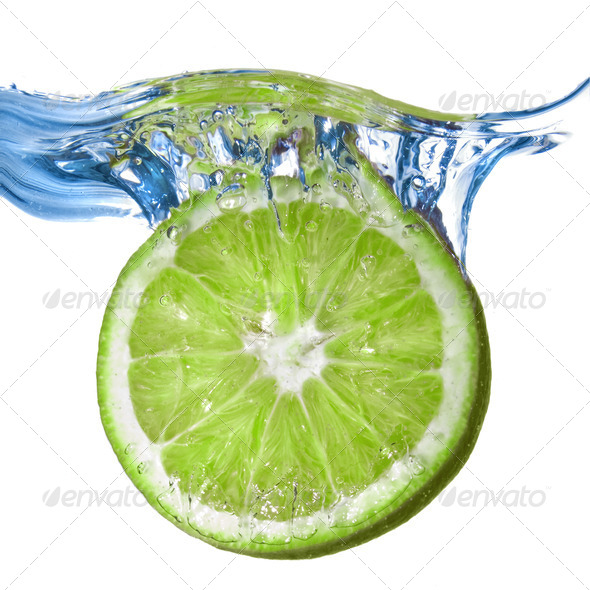 Fresh lime dropped into water isolated on white - Stock Photo - Images