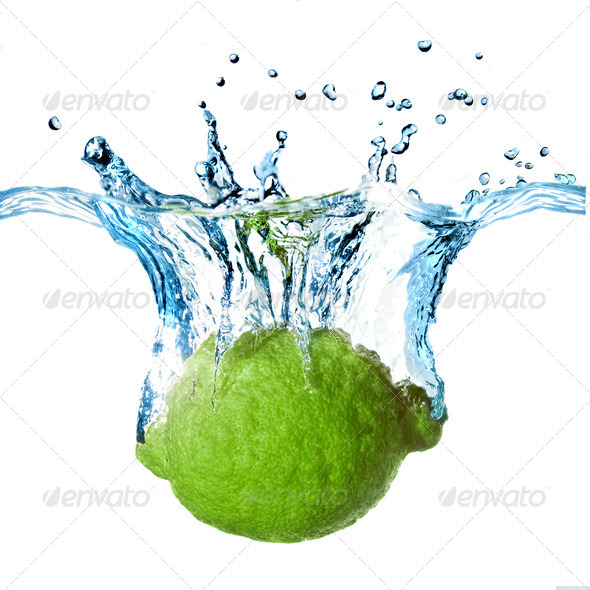 Fresh lime dropped into water with splash isolated on white - Stock Photo - Images