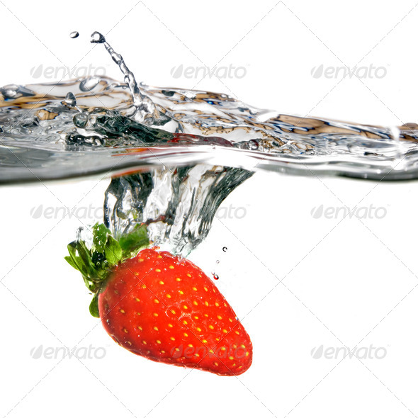 Fresh strawberry dropped into water with splash isolated on whit - Stock Photo - Images