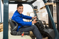 Portrait of driver operating forklift machine in warehouse - PhotoDune Item for Sale