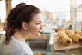 Woman eyeing up tray of pastrys at the bakery