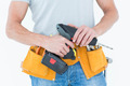 Cropped image of repairman holding handheld drill over white background - PhotoDune Item for Sale