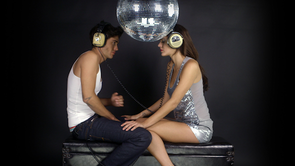 Young Couple Dancing With Retro Headphones 6