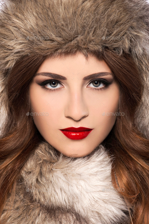 Beautiful young woman with fur hat - Stock Photo - Images