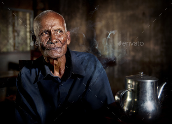 An Old Tea house And A Man In It - Stock Photo - Images