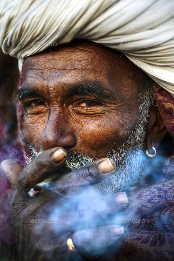 Indigenous Indian Man Smoking Happily - Stock Photo - Images