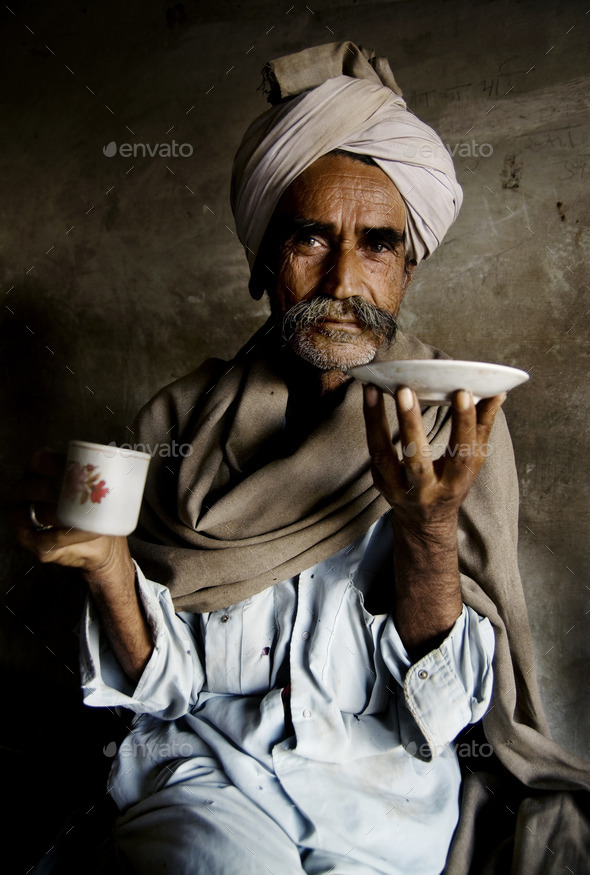 Portrait of a Rajasthani Indian Man at an Early Morning Market - Stock Photo - Images