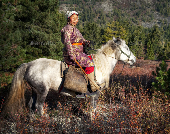 Woman Riding A Horse In A Scenic View - Stock Photo - Images