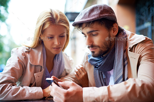 Reading sms - Stock Photo - Images